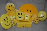 10Smiley Face Items: stuffed toy, soccer ball, frizbe, clock, etc